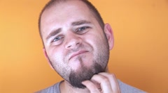 Young Man Scratching His Beard Stock Footage