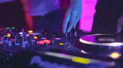 DJ control desk, woman hand mixing, spinning in a Night Club Stock Footage