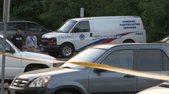 Toronto police officers at gun related shooting murder crime scene Stock Footage
