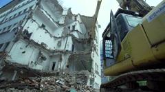 Huge excavator destroys a residential building Stock Footage