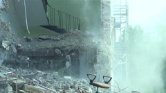 pieces of concrete and dust falls from the destroyed building in slow motion - stock footage