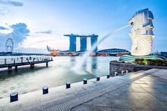 Singapore landmark skyline with sunrise Stock Photos