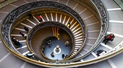 People descend the modern double helix staircase. Vatican Museums, Rome, Italy Stock Footage