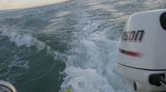 High speed sea traveling by motor boat. View of engine with waves Stock Footage