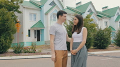 Young family in front of new house - stock footage