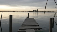 Jetty dock sunset slow calm water relaxing meditation scene river lake 4k Stock Footage