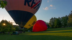 Time-lapse video of colorful hot air balloons launch. 4K UHD wide angle shot Stock Footage