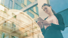 Business woman using cell phone - stock footage