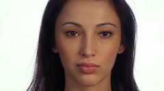 Young Woman Looks Very Skeptical Questioningly. - stock footage