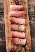 Curled Slices of Delicious Prosciutto with spice  Italian cuisine Stock Photos