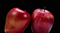 Red apple turning - macro - stock footage