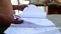 Work studying drawing at a construction site Stock Footage