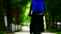 Anonymous cyclist riding in natural green environment Stock Footage