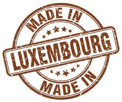 made in Luxembourg brown grunge round stamp - stock illustration