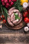 Fresh butcher cut meat assortment garnished with fresh rosemary on wooden tab - stock photo