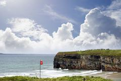 Red flag above ballybunion beach Stock Photos