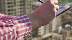 Engineer takes notes on drawings. hands close-up Stock Footage