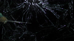 Plate glass window broken by blunt weapon isolated on black in slo-mo Stock Footage