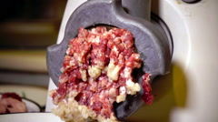 Forcemeat preparation in an electric meat grinder Stock Footage