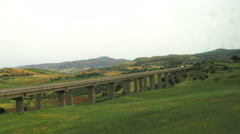 View of the Italian landscape from the train window (in motion Stock Footage