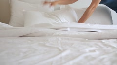 Asian woman making bed Stock Footage