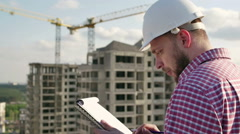 Engineer looking on project on construction site Stock Footage