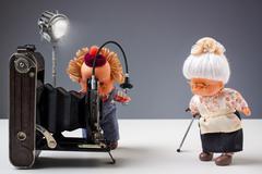 Nostalgic photographic moment with dolls - stock photo