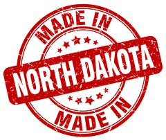 made in North Dakota red grunge round stamp - stock illustration