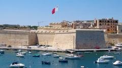View on Malta bay between Kalkara and Birgu with yahts and waving flag Stock Footage