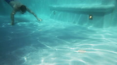 The man swims under water in the pool Stock Footage