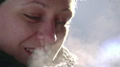 Beautiful woman drinking hot beverage Stock Footage