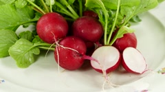 Radish on plate, rotating clockwise Stock Footage