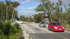 Scooters & cars traffic at Bermuda scenic road (South road). Stock Footage