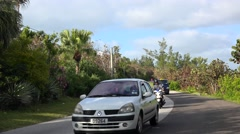 Scooters & cars traffic at Bermuda scenic road (South road). - stock footage