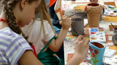 Girl who paints a ceramic bowl 3 - stock footage