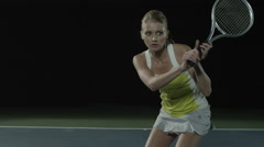 Female tennis player returns a serve in slow motion Stock Footage