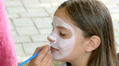 Workshop with face painting for children - stock footage