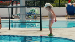 Attractive mother and little cute child having fun by the pool. - stock footage