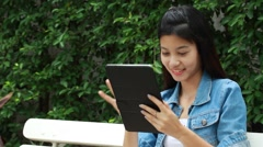 Asia thai adult Women jeans denim girl using her tablet. Stock Footage
