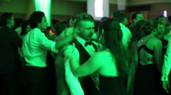 Happy young couple dancing in a night club with green light Stock Footage