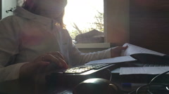 Girl in the morning typing on the keyboard Stock Footage