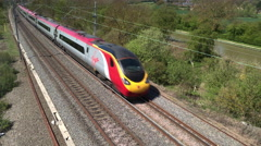 A Virgin Trains Pendolino tilting passenger train Stock Footage