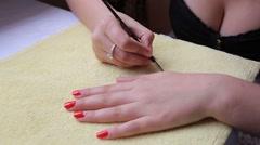Woman applying pink nail polish - stock footage