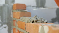 Work lays bricks on a construction site Stock Footage