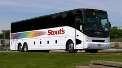 Stouts Bus Lines motorcoach, highway traffic - stock footage