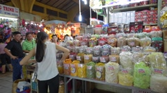 People buy candies or dried fruit at the Ben Thanh market Stock Footage