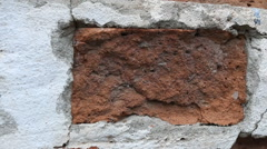 Destroyed red brick wall. - stock footage