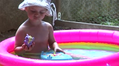 Little girl in the pool Stock Footage
