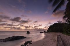 Colorful sunset long exposure at Anse Source D'Argent in La Digue, Seychelles - stock photo