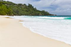 Beautiful Anse Intendance in the south of Mahe, Seychelles with tall waves Stock Photos